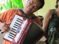 Nikki, who helps run the Bali operation there, playing my accordion