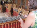 Having a go on a real gamelan instrument at a temple