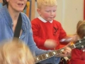 Children in Leicester enjoying music with their families