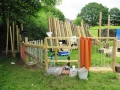 Outdoor structure made at a nursery in Leicester with Matt Shaw including xylophone, spinner, tube-o-phone, door-viewer panel, water-hose-experiment, scaffold-pole-chimes, stake passage and pigeon
